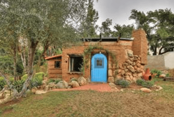 Tiny adobe house has a big price tag tiny house websites for Small adobe house plans